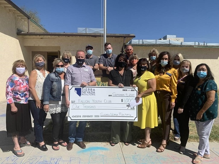 Realtors make donation to Youth Club