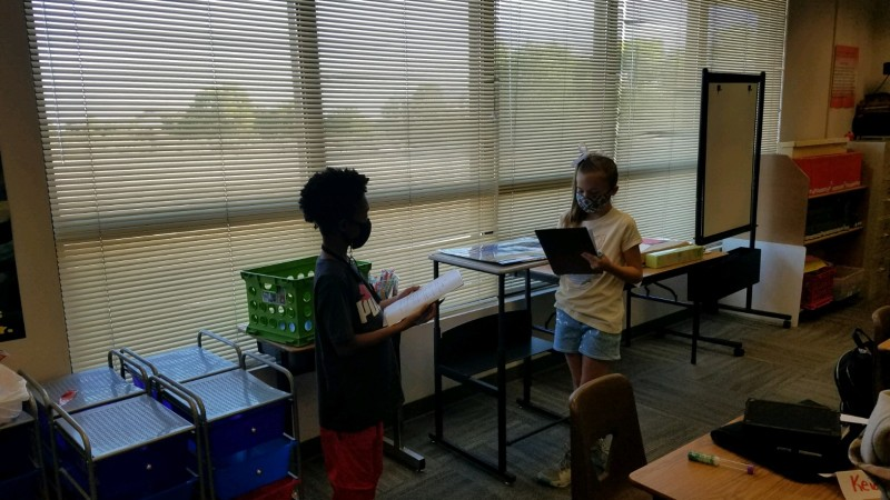 5th graders Keiandrea Milbrook and Angela Gonzales (by window)
